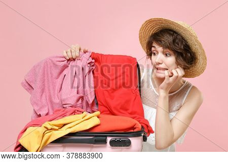 Confused Tourist Woman In Summer Dress Hat Isolated On Pink Background. Female Traveling Abroad To T