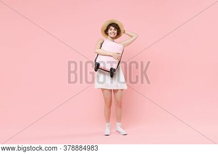 Smiling Young Tourist Girl In Summer White Dress Hat Isolated On Pink Background Studio. Female Trav