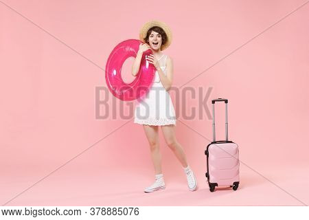Excited Young Tourist Woman In Summer White Dress Hat With Suitcase Isolated On Pink Background. Fem