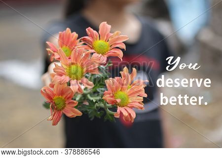 Inspirational Motivational Quote - You Deserve Better. With Young Girl Holding And Showing Beautiful