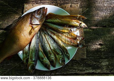 Smoked Fish Perch, Capelin On An Old Wooden Table, Top View