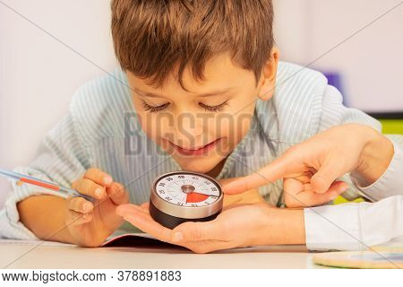 Boy With Autism Spectrum Disorder During Aba Therapy Look At Lesson Timer In Teachers Hands Understa