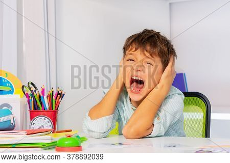 Screaming Sad Boy With Autistic Disorder Cover Ears And Scream During Development Therapy Class Less
