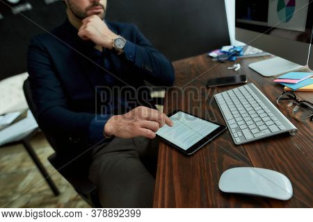 Business And Finance Concept. Young Businessman, Sales Manager Sitting At His Workplace In The Moder