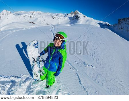 Wide Mountain Panorama And Cute Little Smiling Boy Hold Snowboard In Hand Aside, View From Above Wit
