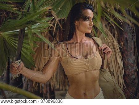 Female Holding Machete Posing On Wild Nature Of Palm Trees Forest. Spirit Of Adventure. Survivor Wom