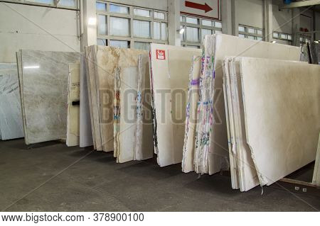 Colorful Marble Slabs In Store Show Room. Granite Slabs Are Prepared For Sale In Store Yard