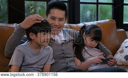 Family Concept. Father And Children Are Doing Happy Household Activities. 4k Resolution.