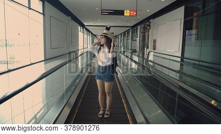 Tourism Concept. An Asian Woman Is Traveling To The Airport. 4k Resolution.