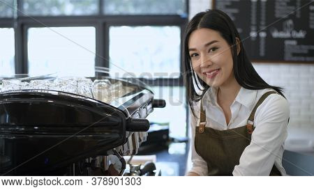 Coffee Shop Concept. The Female Staff Wiping And Cleaning The Shop\'s Equipment. 4k Resolution.