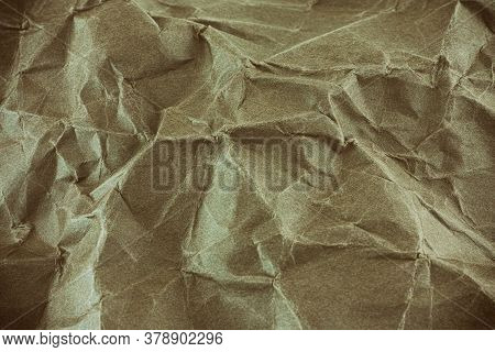 Beige Crumpled Paper Background. Vignette. Close Up.
