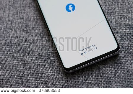 New-york , Usa - June 18 , 2020: Launching  Facebook App On Smartphone Screen Close Up View In Gray