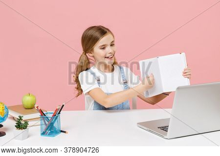 Cheerful Little Kid Schoolgirl 12-13 Years Old Sit Study At Desk Isolated On Pink Background. School