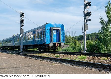 Out Of Date Passenger Train Outside The City.