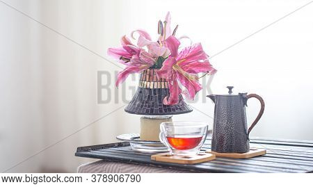 Wooden Tray With Teapot And Cup Of Tea And Beautiful Lily Flowers. Cozy Interior. The Concept Of Res