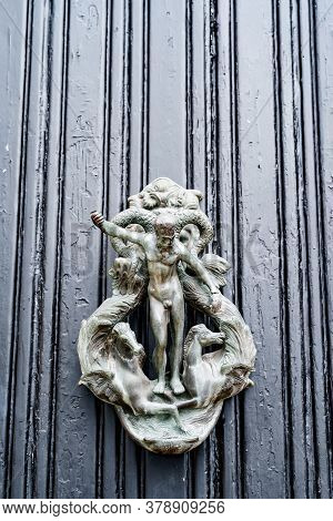 Antique Ring Door Handle With Antique Male Figure And Horses.