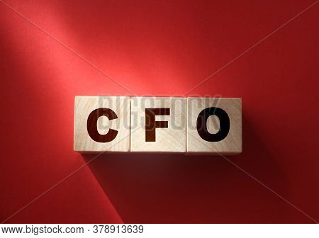 Cfo Letters On Cubes On A Red Background. Chief Financial Officer Concept