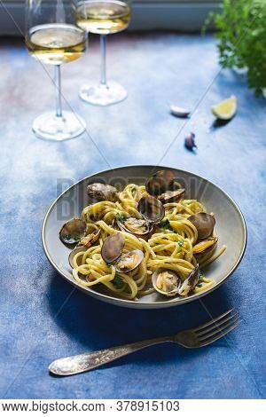 Italian Cuisine, Spaghetti Pasta With Vongole Clams On Blue Background