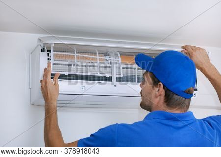 Air Conditioner Maintenance And Repair Service. Hvac Technician Working