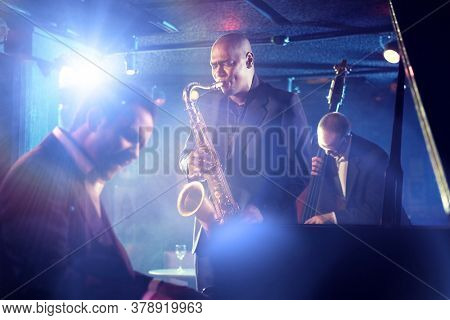 Portrait of Jazz Band playing on Stage