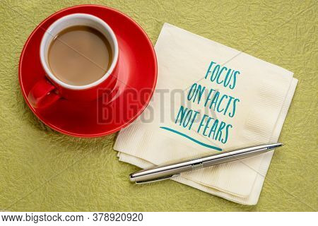 focus on facts, not fears inspirational note - handwriting on a