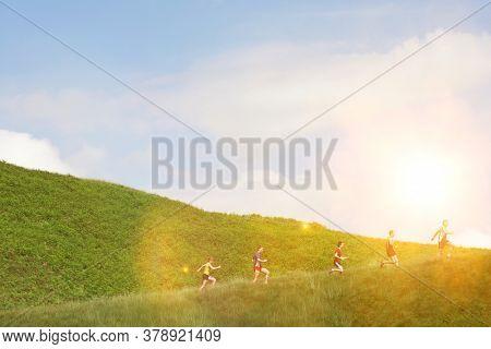 Group photo of jogging up hillside