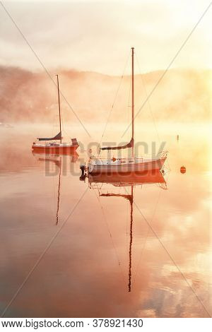 Boat in morning foggy lake at sunrise in Mont Tremblant in Canada