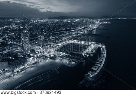 Barcelona coast pier aerial view at night in Spain