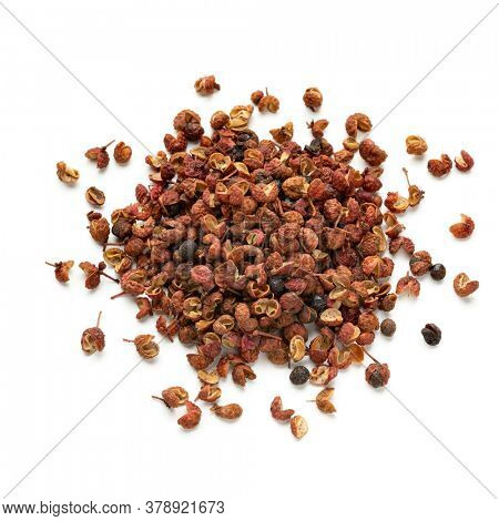 Heap of dried Sichuan pepper seeds isolated on white background