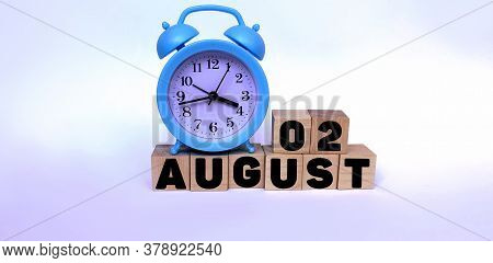 August 2.august 2 On Wooden Cubes On A White Background.blue Watch.photos For The Holiday .the Last