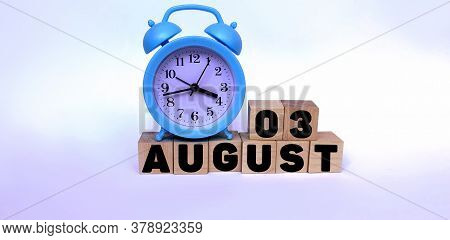 August 3.august 3 On Wooden Cubes On A White Background.blue Watch.photos For The Holiday .the Last
