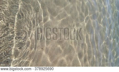 Sea ​​waves Background. Transparent Waves In The Clear Sea. Beach Sand. Relax At Sea. Background For