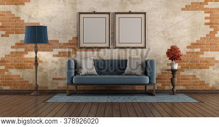 Living Room With Blue Classic Sofa,floor Lamp And Picture Frane Agaist Old Brick Wall - 3d Rendering