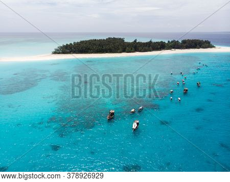 Aerial View Of Mnemba Atoll In Zanzibar - The Famous Spot For Snorkeling And Boat Tour