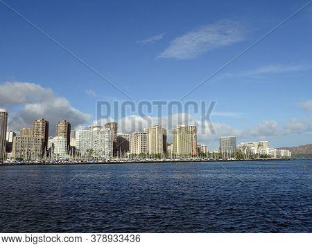 Honolulu - July 28, 2017: Ala Moana Boat Harbor, Ilikai Hotel, Hilton Hawaiian, Other Waikiki Hotels