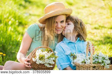 Happy Holidays. Mother And Cute Son Wear Hats. Family Farm. Spring Holiday. Wildflowers In Field. Mo