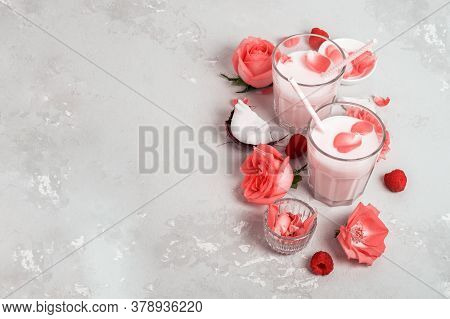 A Group Of Lunar Milk Glasses With Roses On Light Concrete With A Copy Of Space.