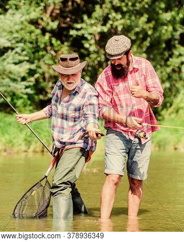 Teamwork. Father And Son Fishing. Summer Weekend. Mature Men Fisher. Hobby And Sport Activity. Trout