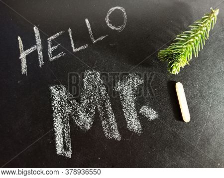 Hello Mister I Text Displayed On Chalk Board Concept With Wooden Alphabet English Symbol.