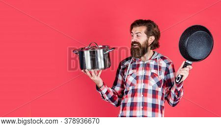 Prepare Meal Food At Home. Professional Cook. Bearded Man Hold Kitchen Pan. Brutal Hipster Cooking W
