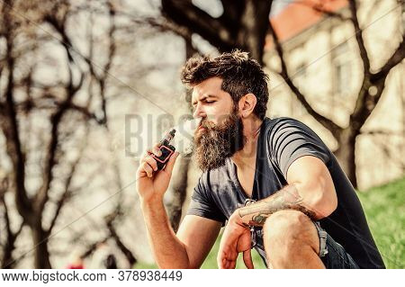 Perfect Style. Health Safety And Addiction. Inhaling Vapor. Man Smoking E-cigarette. Mature Hipster