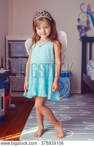 Cute Adorable Pretty Dressed Preschool Girl Playing Fairy Princess At Home. Child Creativity Imagina