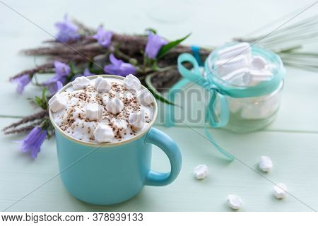 Hot Chocolate With Whipped Milk Froth And Marshmallows In A Blue Cup. On A Turquoise Background.