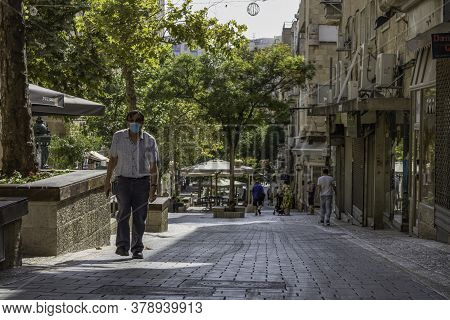 Jerusalem, Israel - July 30th, 2020: Ben - Yehuda pedestrian mall, usually a crowded main street of Jerusalem, almost empty at COVID times.