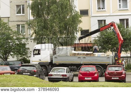 A Body Truck With An Open Body Is Parked In The Courtyard Of A Body Truck In The Courtyard Of A Mult