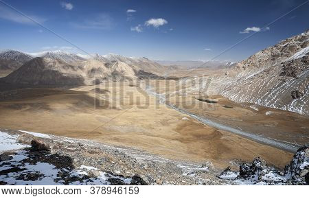 View Of The Landscape With A Valley And Riverbed In The Mountains. Mountain Terrain On The Border Of
