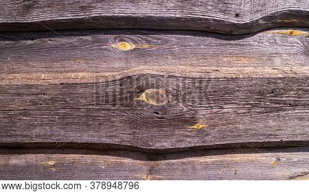 Old Dark Rough Wood Surface With Splinters And Knots. Old Aged Timber In A Barn Or Old House. Natura