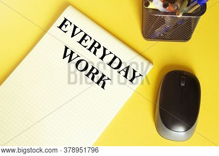 Computer Mouse, Pens, Felt-tip Pens, Notepad With Text Everyday Work On A Yellow Background