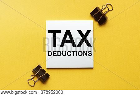 White Paper With Text Tax Deductions On A Yellow Background With Stationery