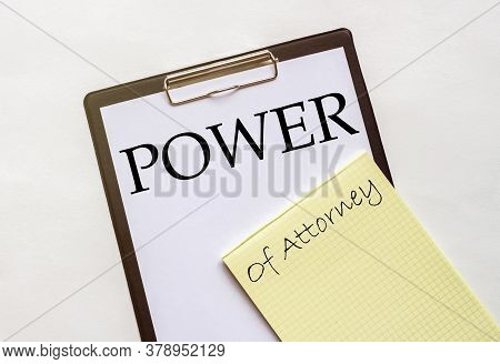 White And Yellow Paper With Text Power Of Attorney On A White Background With Stationery